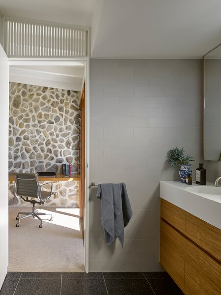 On this side of the chimney, the office also has a door onto the front terrace. The slatted detail was repeated above the bathroom door.