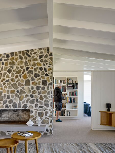 In place of a warren of rooms, the architects installed a comfortable suite for Neil and Shirley on the other side of the chimney that includes an office space, walk-in closet, private bathroom, and bedroom that overlooks the ocean.