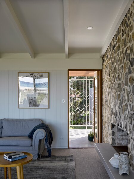 A glass door brings more light into the living room.