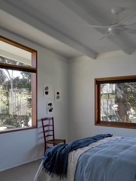 One of the guest rooms, with large windows overlooking the front yard.