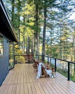 "A new second-floor deck was wrapped in 2020, and at $25,000, a sizeable chunk of the budget. But worth it, considering it makes for a serene spot to sit and soak up the river and forest views. ""The sound of the river rushing can't be beat,"" says Devlin."