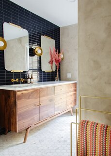 The first phase of the remodel enlarged the footprint in the main bathroom, which pairs marble hex tile on the floor with Fireclay tile on the walls. The mirrors were $506 from Rejuvenation, and the sconces are by Nino Shea Design ($660 for three).