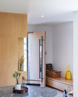 A built-in bench at the entry provides storage—a boon, granted the home's compact footprint.