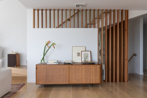 The vintage credenza once belonged to the architect's grandmother, and the framed drawing on the right is by Graham's mother, artist MJ Levy-Dickson.