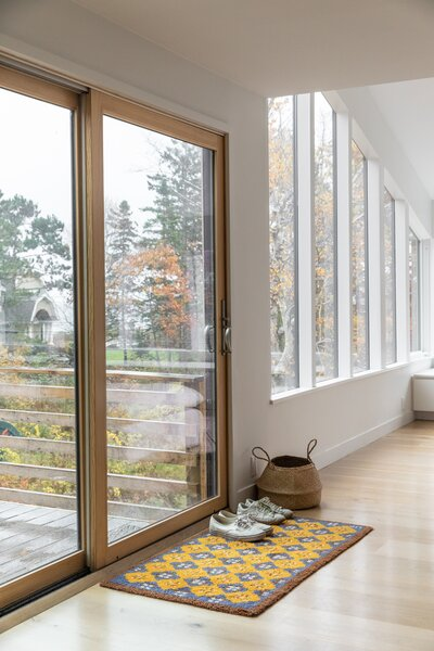 The new sliding door is by Jeld-Wen, while the rug was found at a local shop called Portia's Barn. The floors are white oak.