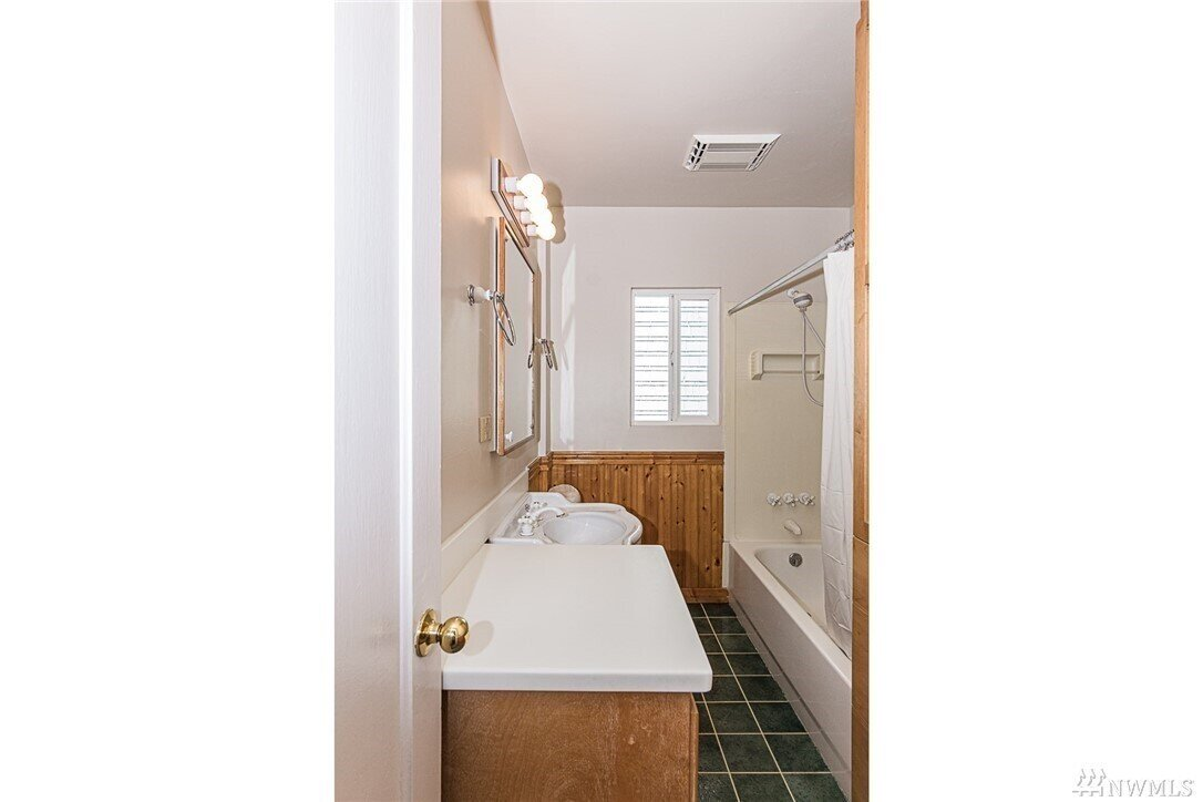 Before: Bathroom in Black Sheep Remodel by SHED Architecture & Design