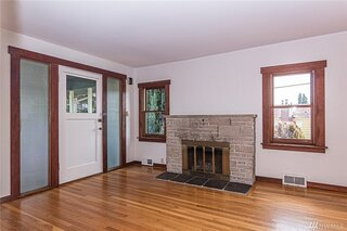 """Before: The front door opened to the fireplace. """"You couldn't put furniture around the fireplace in the original plan,"""" says Hale."""