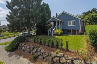 """Before: The bungalow sits on a lovely corner lot and has a beautiful view of Mount Rainier. The owners wanted their renovation """"to maintain the character of the neighborhood,"""" says Prentis Hale of SHED Architecture & Design."""