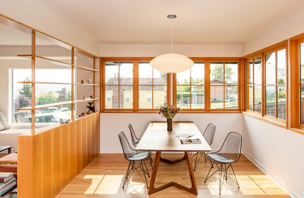 The new windows echo the style of the old ones while providing improved energy efficiency. The wood trim syncs with the new casework elsewhere in the home.