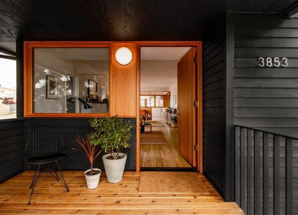 The firm shrank the footprint of the front porch to give the living room more interior space. New fir casework can be found throughout the renovation, and the siding is painted in Benjamin Moore Wrought Iron.