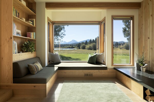 Now, built-in sofas line the perimeter of the room and utilize the room's shape better.