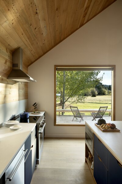 The kitchen now benefits from the great room's large windows and views.