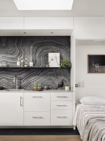 """Garcia specified display space, complete with a shelf, behind the Murphy bed, so that it """"creates a moment"""" when the bed is folded down, the architect says."""