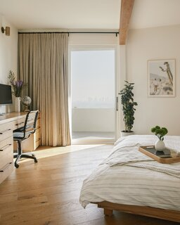 Cheng had to borrow space from the bedroom to create a more functional bathroom, but a built-in dresser and desk keep the layout feeling spacious.