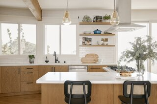 Now, the family can hang out at the breakfast bar, on Domino Bar Stools from Industry West or at the nearby dining room table, while the cook works. The gold pendant lights are Nuura's Anoli 1 pendant, sourced from the Finnish Design Shop.