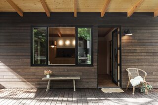 Architectural designer Grey Shaeffer of Willa Work designed a petite backyard guesthouse at her Portland, Oregon, home for occasions when her mom comes to visit. The siding and decking are a fused bamboo product from Dasso XTR, in classic espresso.