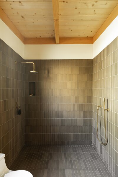 Quarry Pavers from Seneca Tiles cover the bathroom. All of the fixtures are from Sigma, and they were originally chrome before Grey stripped and refinished them.