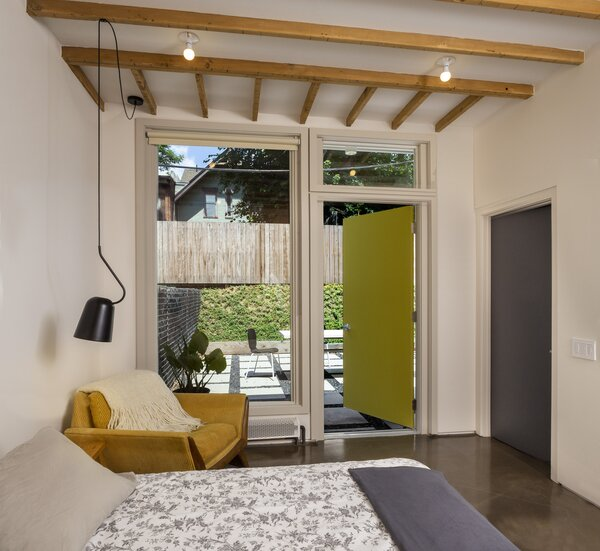 A new door and window combination improve access to the private garden.