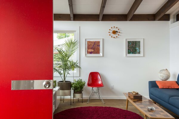 A bright red entry door is a nod to the era of the home.