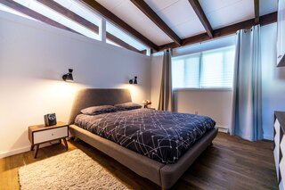 """""""We added the triangular transom to be able to see the continuation of the ceiling beams, as well as get more sunlight into the bedroom,"""" says Azin."""