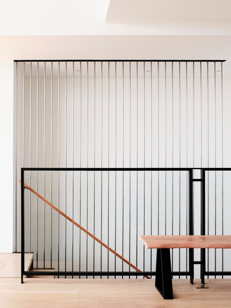 The staircase presents a sculptural moment and leads fluidly into the open living spaces.
