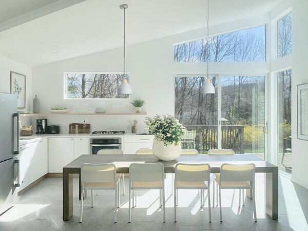 Now, the kitchen benefits from all the natural light brought in by the bump-out. The cabinets are Ikea's Sektion cainets with their base line Veddinge white lacquer finish fronts, topped with Ikea quartz counters. The hardware includes knobs from Lowe's and pulls from Manzoni.
