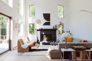 A Room & Board record console behind the couch is mixed with a vintage mushroom lamp and Flos Arco Floor Lamp.
