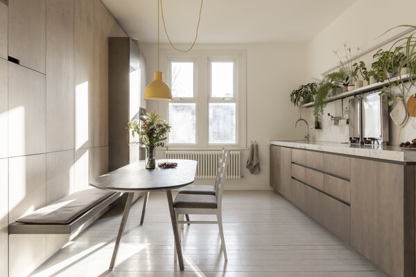 On the main level, Alessia relocated the kitchen into what was a large bedroom, so as to give the kitchen more functionality and connect it to the living room. The cooktops can pivot up against the backsplash to create more prep space on the counter.