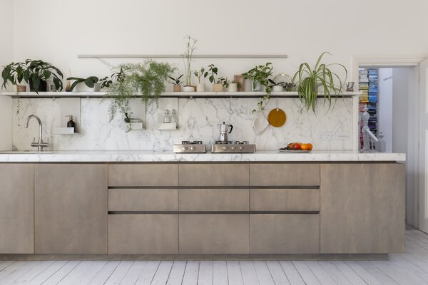 The counter and backsplash are made up of a marble slab leftover from a bigger job.