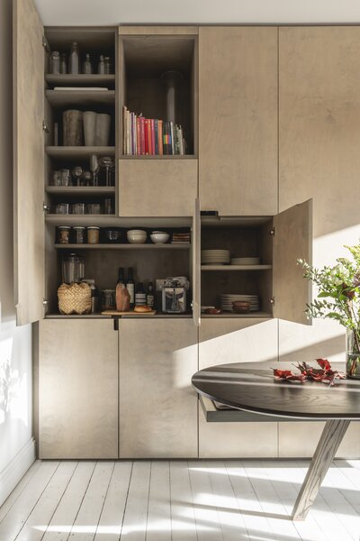 """Alessia's favorite detail? """"I am not a huge fan of handles, so there are only three cuts [in the cabinetry] which lets you open six doors."""""""