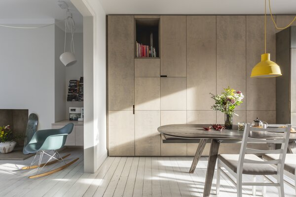 Virtue Joinery built the custom cabinetry, composed of plywood stained a soft grey.