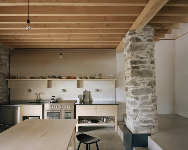 In the kitchen, honed Welsh slate tops pale English Sycamore cabinetry.