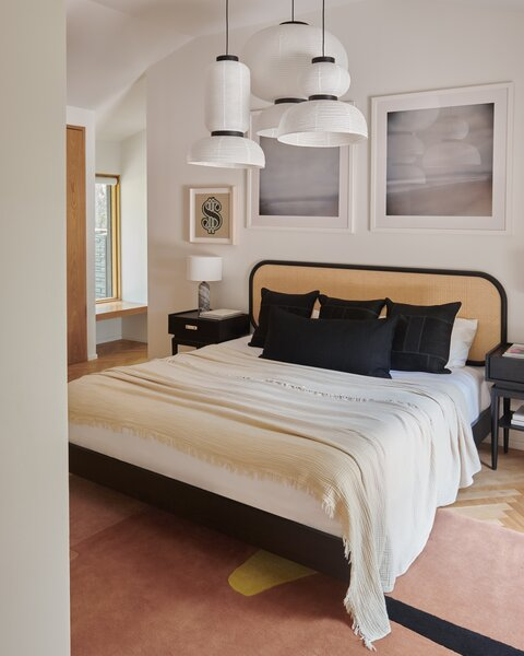 In the bedroom, a party wall is a backdrop for the bed, and there's a generous walk-in closet on the other side of it.
