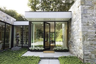 Art and Nature Converge at a Couple's Glass, Cedar, and Stone House in New York