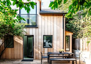 The existing cottage was so run down and neglected it was not livable. The new exterior follows the existing form of the structure with all new building materials for a fresh and timeless look.