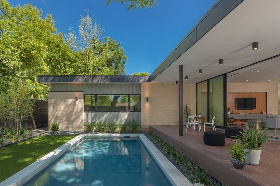 Outdoor, Back Yard, Swimming Pools, Tubs, Shower, Small Pools, Tubs, Shower, Concrete Pools, Tubs, Shower, Large Patio, Porch, Deck, Decking Patio, Porch, Deck, and Horizontal Fences, Wall Backyard  Pavilion Haus by studioMET architects