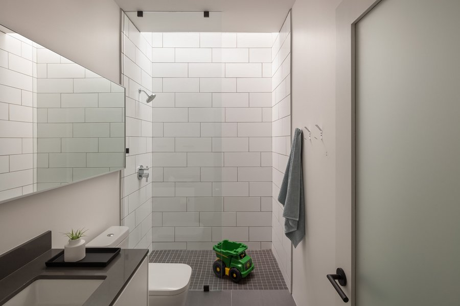 Bath Room, Engineered Quartz Counter, Porcelain Tile Floor, Undermount Sink, Open Shower, Subway Tile Wall, and One Piece Toilet Bathroom  Pavilion Haus by studioMET architects