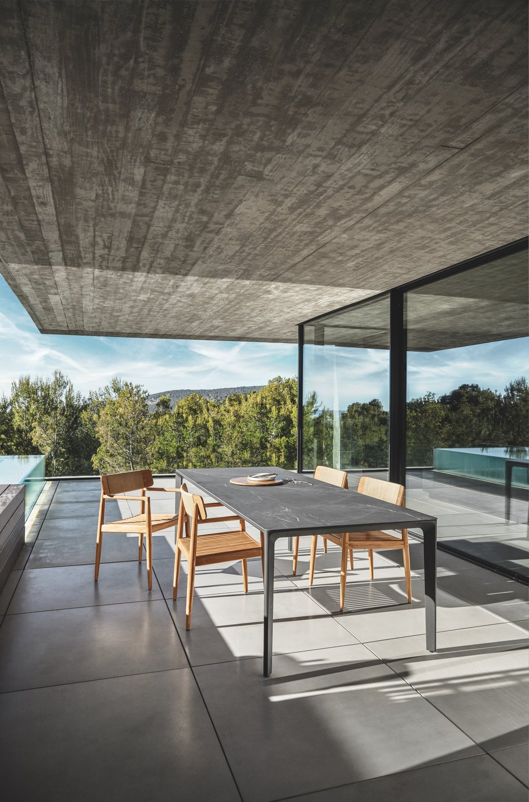 Table, Chair, Concrete, Outdoor, Trees, Large, Back Yard, Infinity, Concrete, Swimming, Large, and Hardscapes Dining with a Scandinavian touch: Archi dining chair combined with Carver table.  Best Outdoor Chair Infinity Back Yard Photos from Dining Chairs