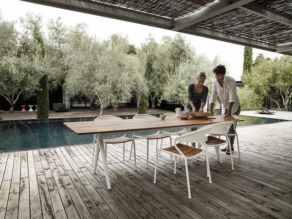 Chair, Table, Outdoor, Large, Wood, Small, Large, Small, Back Yard, Trees, Hardscapes, Swimming, and Gardens Perfect dinner at the Split table with stackable chair Curve.  Best Outdoor Gardens Small Photos from Dining Chairs