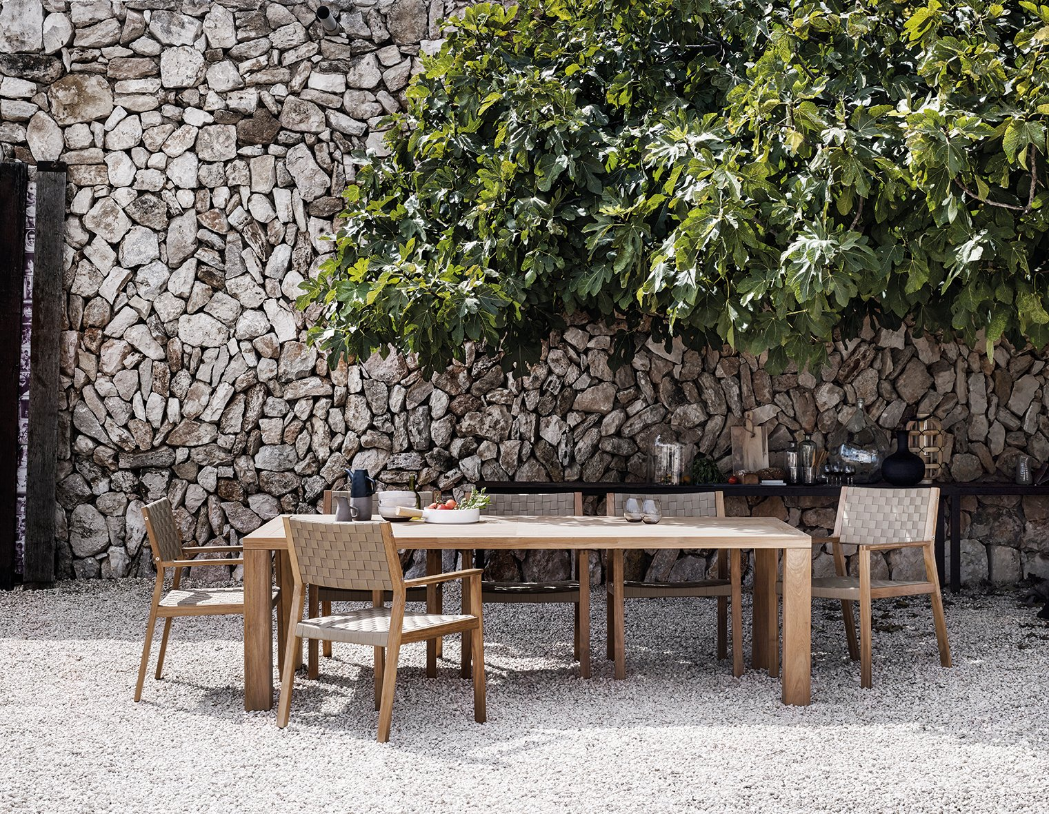 Chair, Table, Outdoor, Trees, Large Patio, Porch, Deck, Back Yard, Stone Patio, Porch, Deck, Hardscapes, and Small Patio, Porch, Deck A harmonious setting with Square table and Maze dining chair in Malt strap.  Dining Chairs