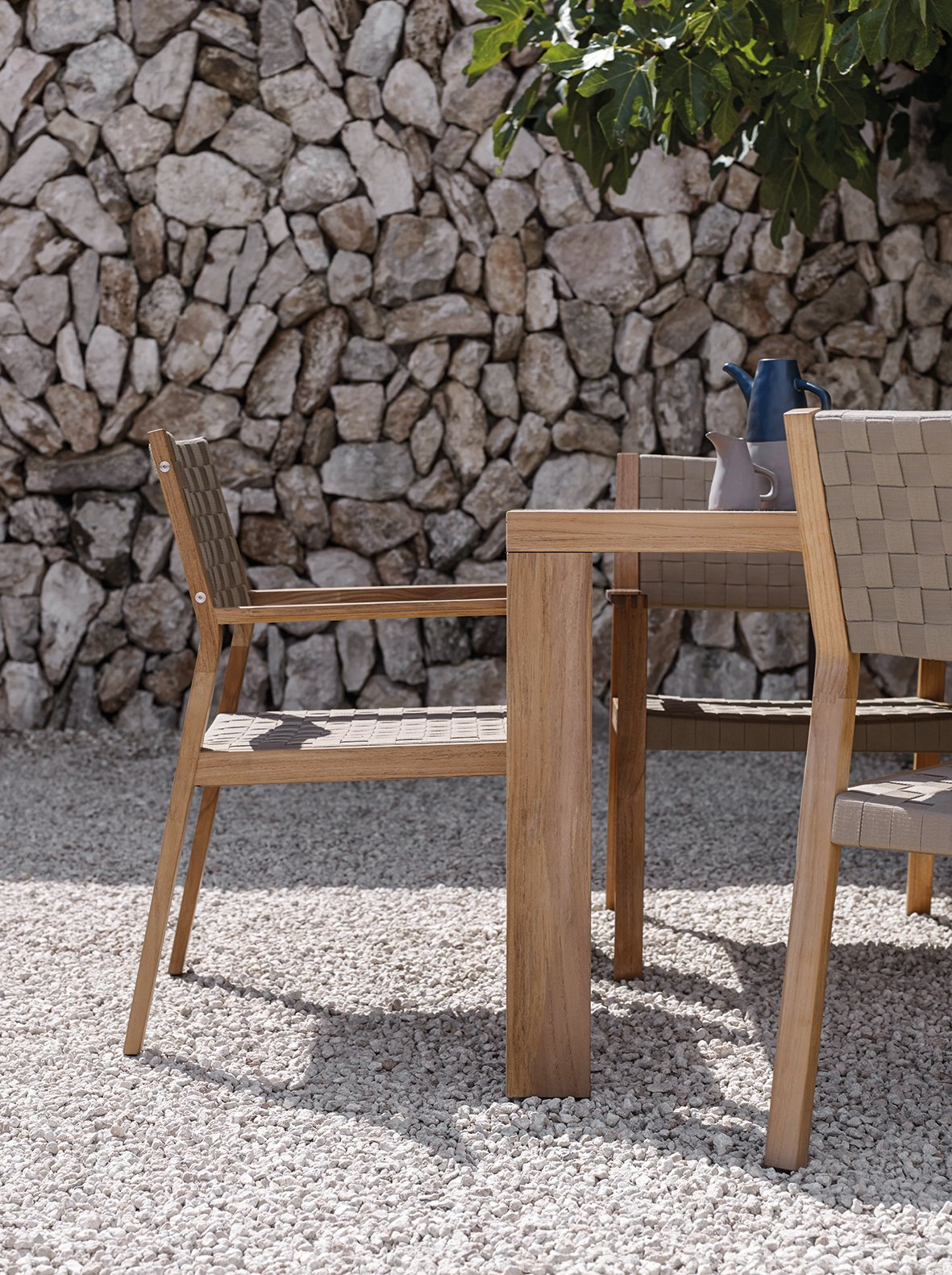Table, Chair, Outdoor, Back Yard, Trees, Hardscapes, Stone Patio, Porch, Deck, Large Patio, Porch, Deck, and Small Patio, Porch, Deck Working with soft outdoor straps woven over angular, teak frames, Maze's unique design offers both visual impact and exceptional comfort.  Dining Chairs