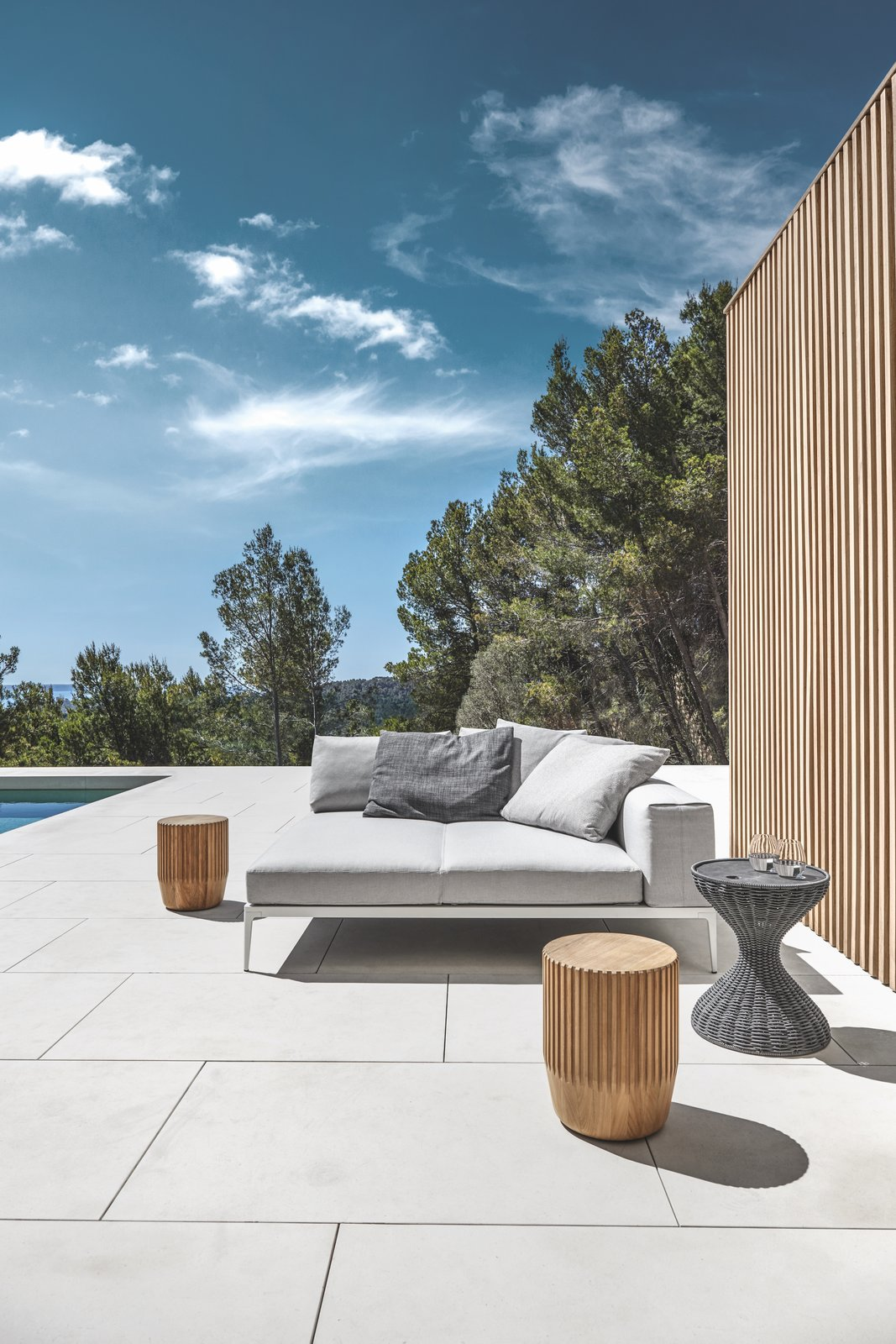 Outdoor, Large, Large, Small, Tile, Small, Trees, Back Yard, Swimming, and Hardscapes A Grid lounging unit combined with woven Bells table and the Teak Log side table.  Best Outdoor Trees Tile Photos from Seating
