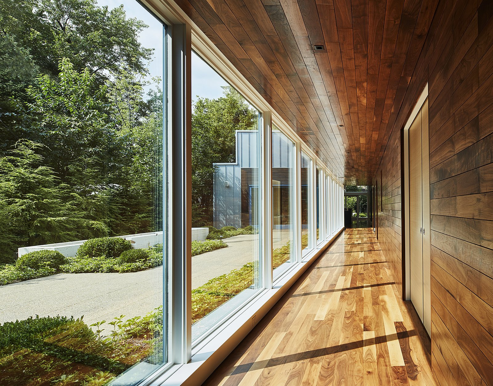 Hallway and Medium Hardwood Floor hallway looking south  Courtyard Residence by Kuklinski + Rappe Architects