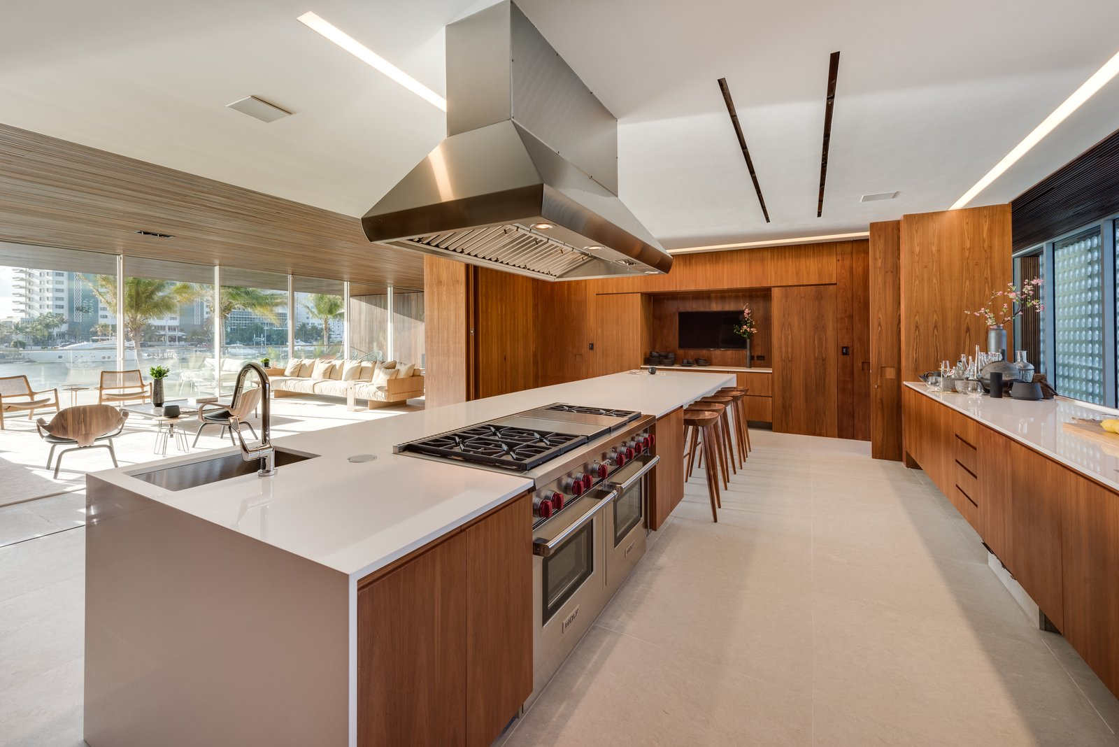 Trees, Gardens, Concrete, Shrubs, Chair, Sofa, Recessed, Limestone, and Kitchen Spacious and bright, the kitchen features a large island with seating and opens up to the living area.  Best Kitchen Recessed Gardens Photos from Pine Tree North
