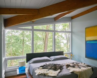 New floor-to-ceiling windows bring dawn light and bird calls into the Master Bedroom.