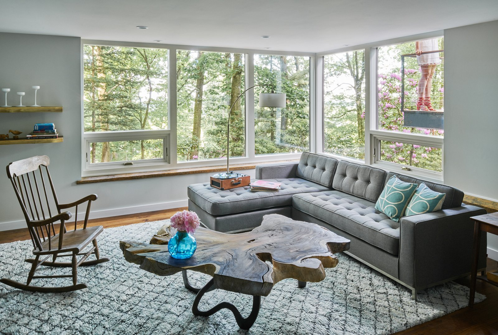 Trees, Storage, Table, Picture, Sofa, End Tables, Coffee Tables, Casement, Shelves, Sectional, Storage, Medium Hardwood, and Living The family room features custom-designed furnishings by the homeowner using exotic wood slabs.  Best Living Shelves Photos from Highland Perch House
