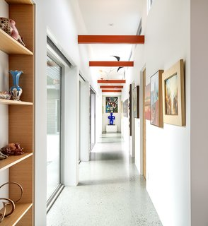 The gallery-like hallway leads to the back of the house.