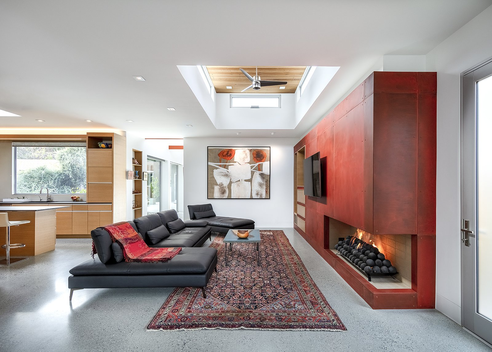 Living Room, Two-Sided Fireplace, Gas Burning Fireplace, Accent Lighting, Concrete Floor, Sectional, Recessed Lighting, and Coffee Tables The living room with it's clerestory pop-up, helping to define the space and bring in light.  Oak Street by Rossington Architecture