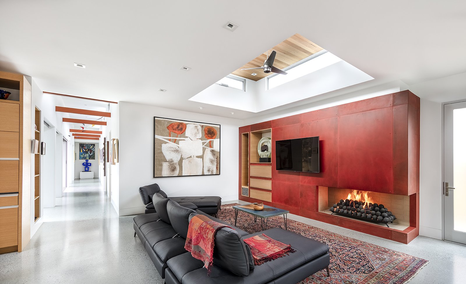 Living Room, Sectional, Accent Lighting, Recessed Lighting, Gas Burning Fireplace, Coffee Tables, Concrete Floor, and Two-Sided Fireplace The fireplace wall is an acid washed and stained steel wrap.  Oak Street by Rossington Architecture