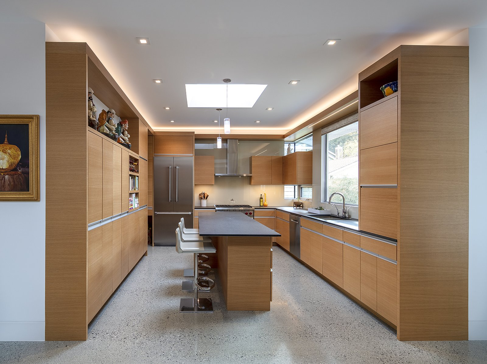 Kitchen, Wood Cabinet, Concrete Floor, Dishwasher, Pendant Lighting, Undermount Sink, Range Hood, Glass Tile Backsplashe, Recessed Lighting, Range, Microwave, Granite Counter, and Refrigerator Rift sawn white oak cabinets in the kitchen.  Oak Street by Rossington Architecture